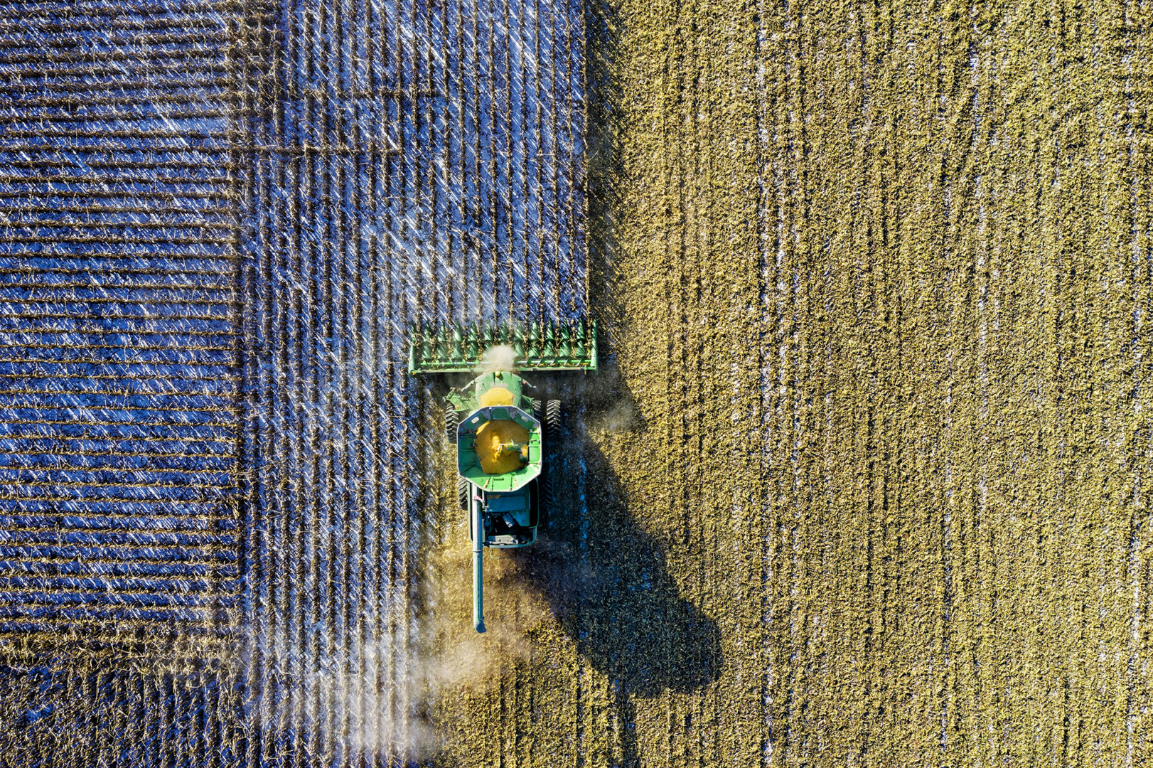 Birds eye photo of combine plowing field