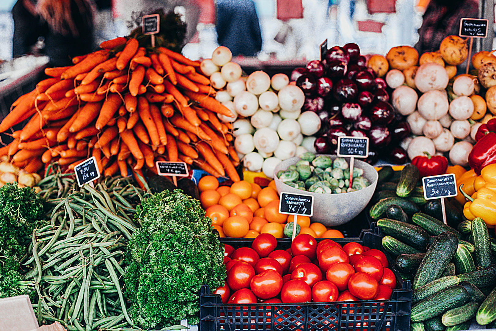 Market stand with baskets of different vegetables