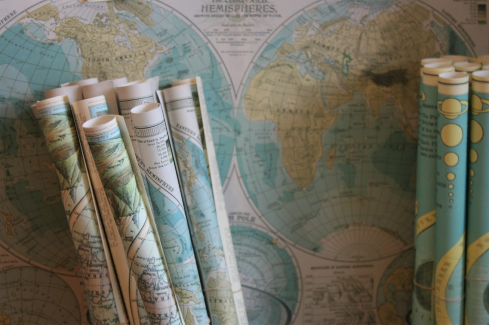 Assortment of rolled up world maps