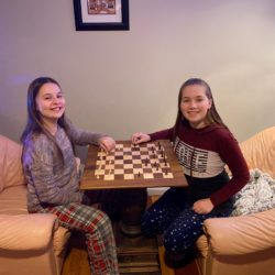 Chess club sisters playing chess
