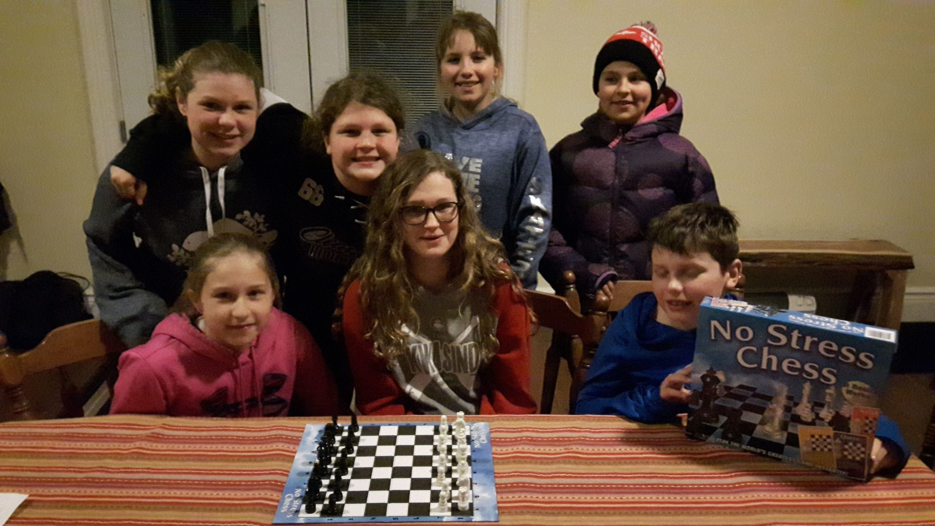 Members at the organization meeting with chess board