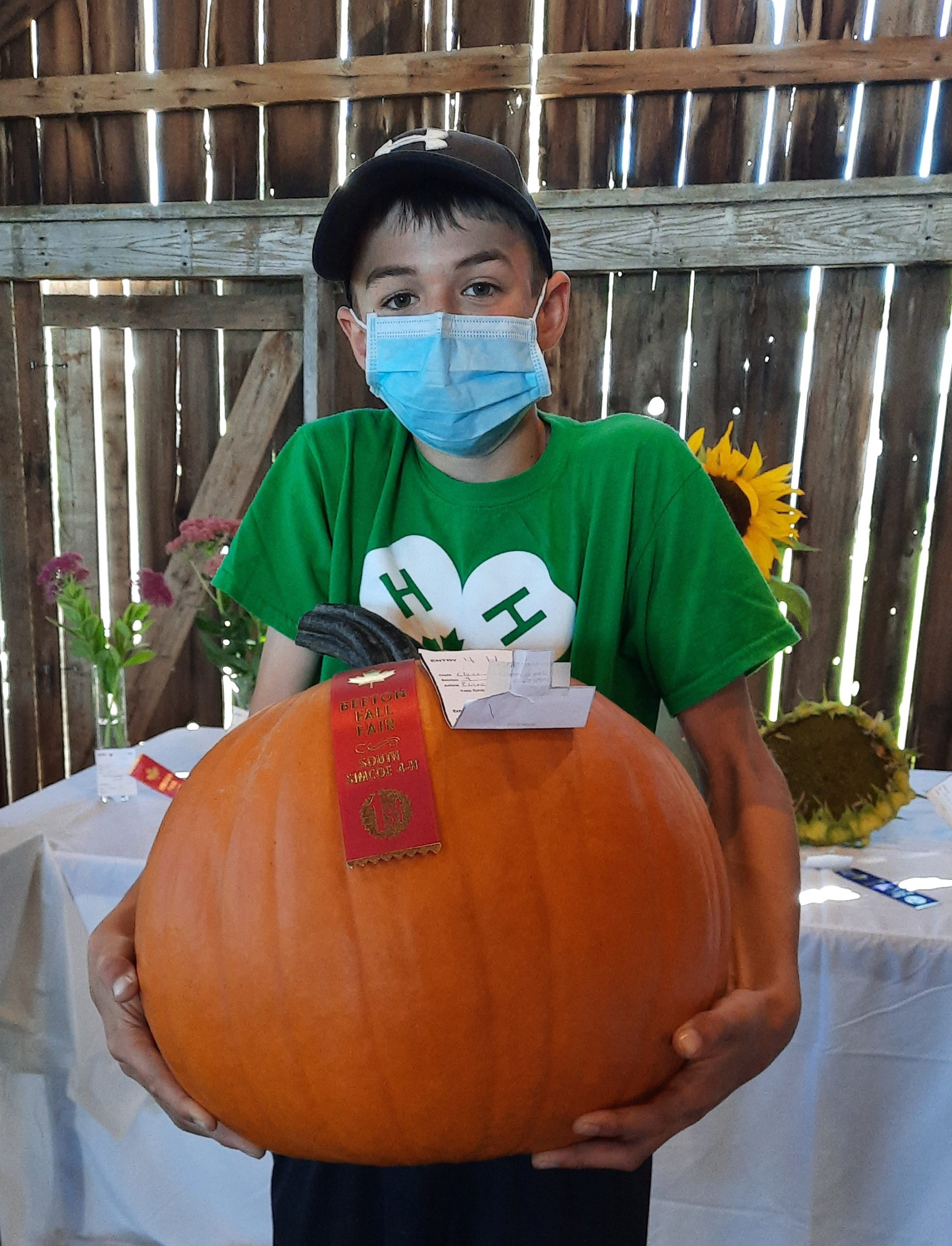 Member with his first prize pumpkin