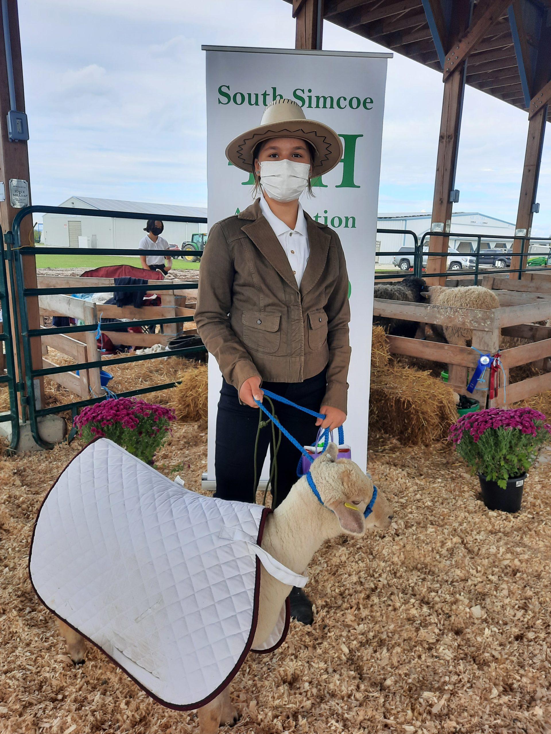 member in costume with her 4-H ewe lamb