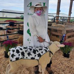 4-H member and ewe lamb in costumes