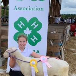 Member with her ewe lamb