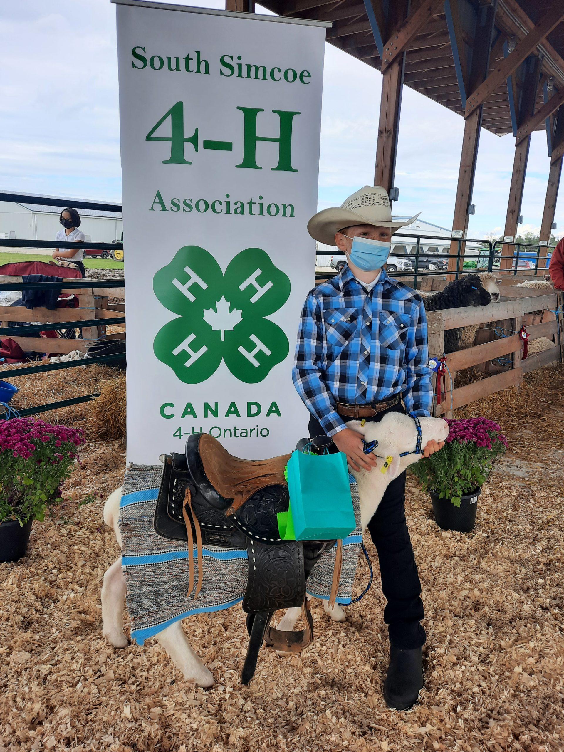 4-H member with ewe lamb in costume