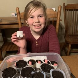 Member showing her homemade seed starter planting containers