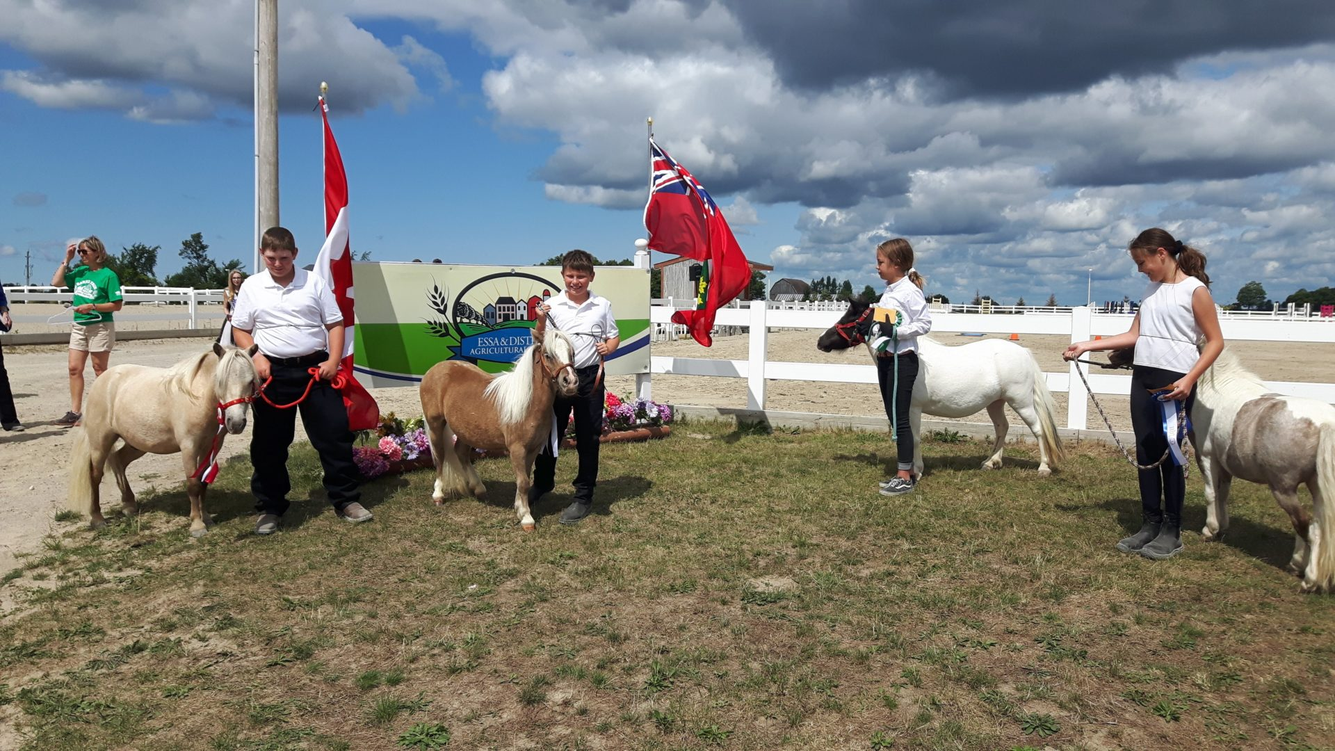 members and horses waiting to enter the show ring