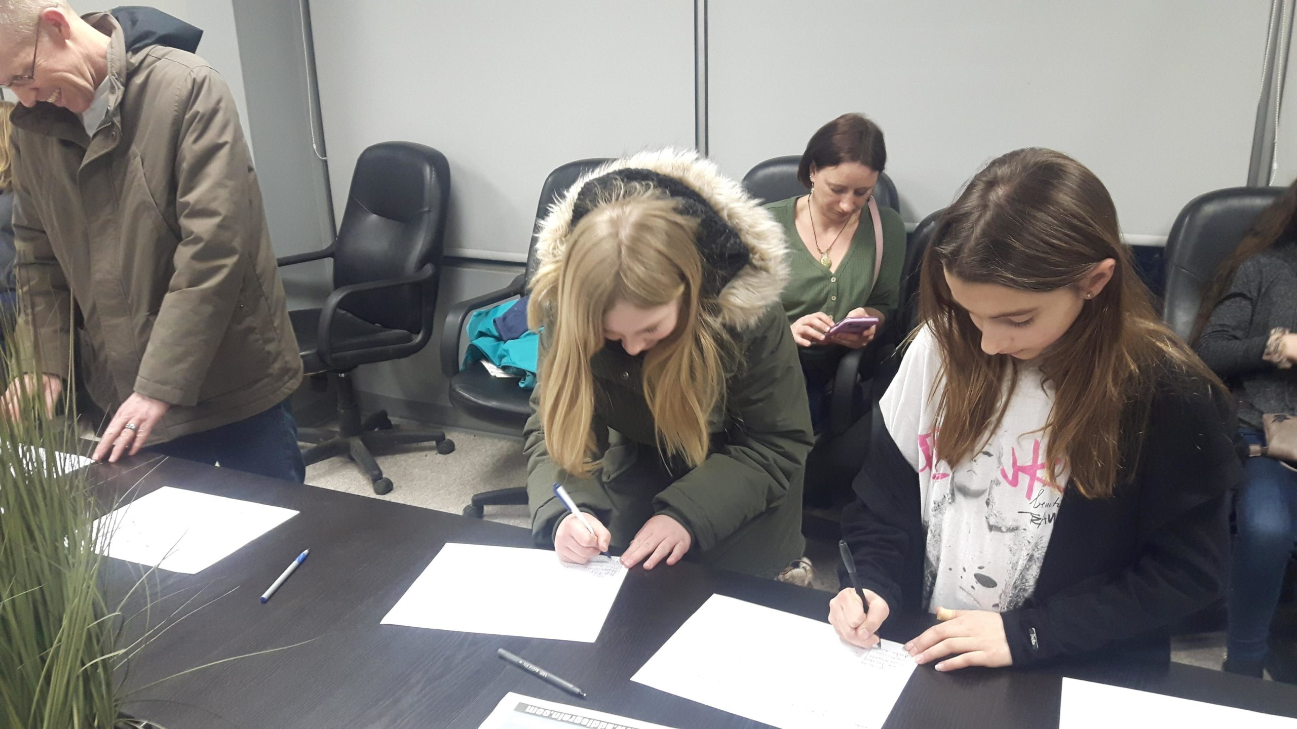Members signing up on club lists