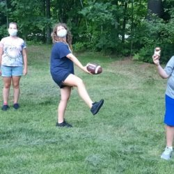 Members kicking the ball around