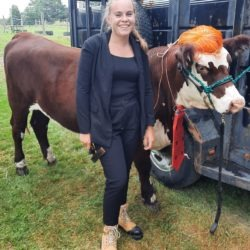 Member with her beef calf dressed as Donald Trump