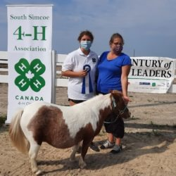 Member with mini horse