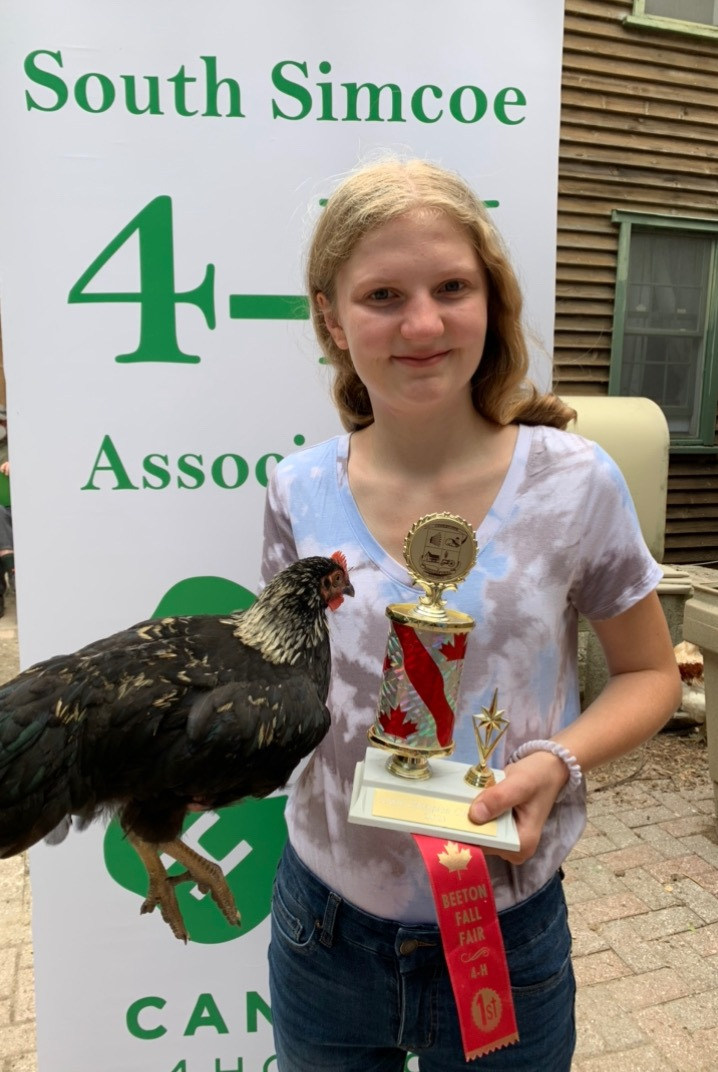 Member with champion 4-H cockerel