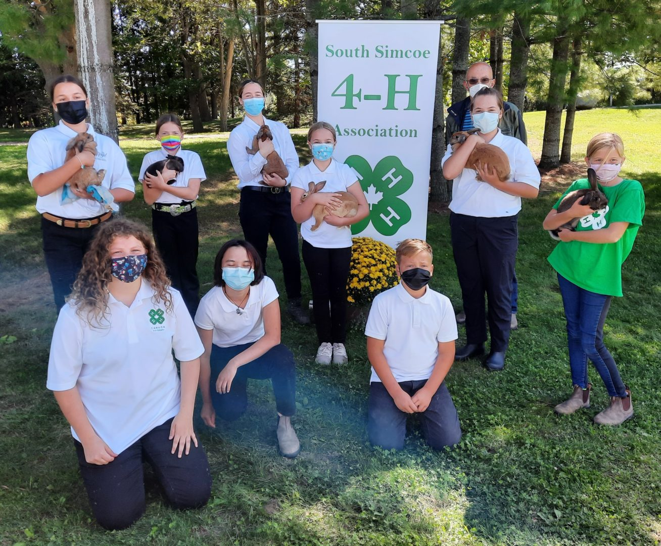 4-H Rabbit club members and judge on achievement day