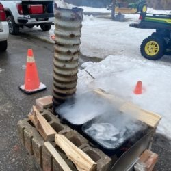 A homemade boiling sap down invention by a 4-H member.