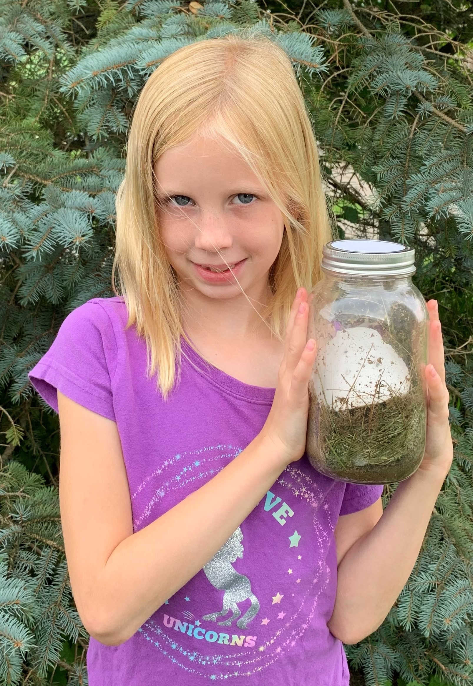Cloverbud member with her meeting made jar composter