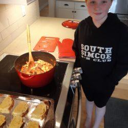member making Irish stew and garlic bread
