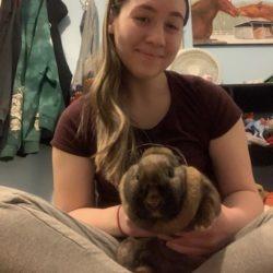 4-H member having fun with her rabbit.