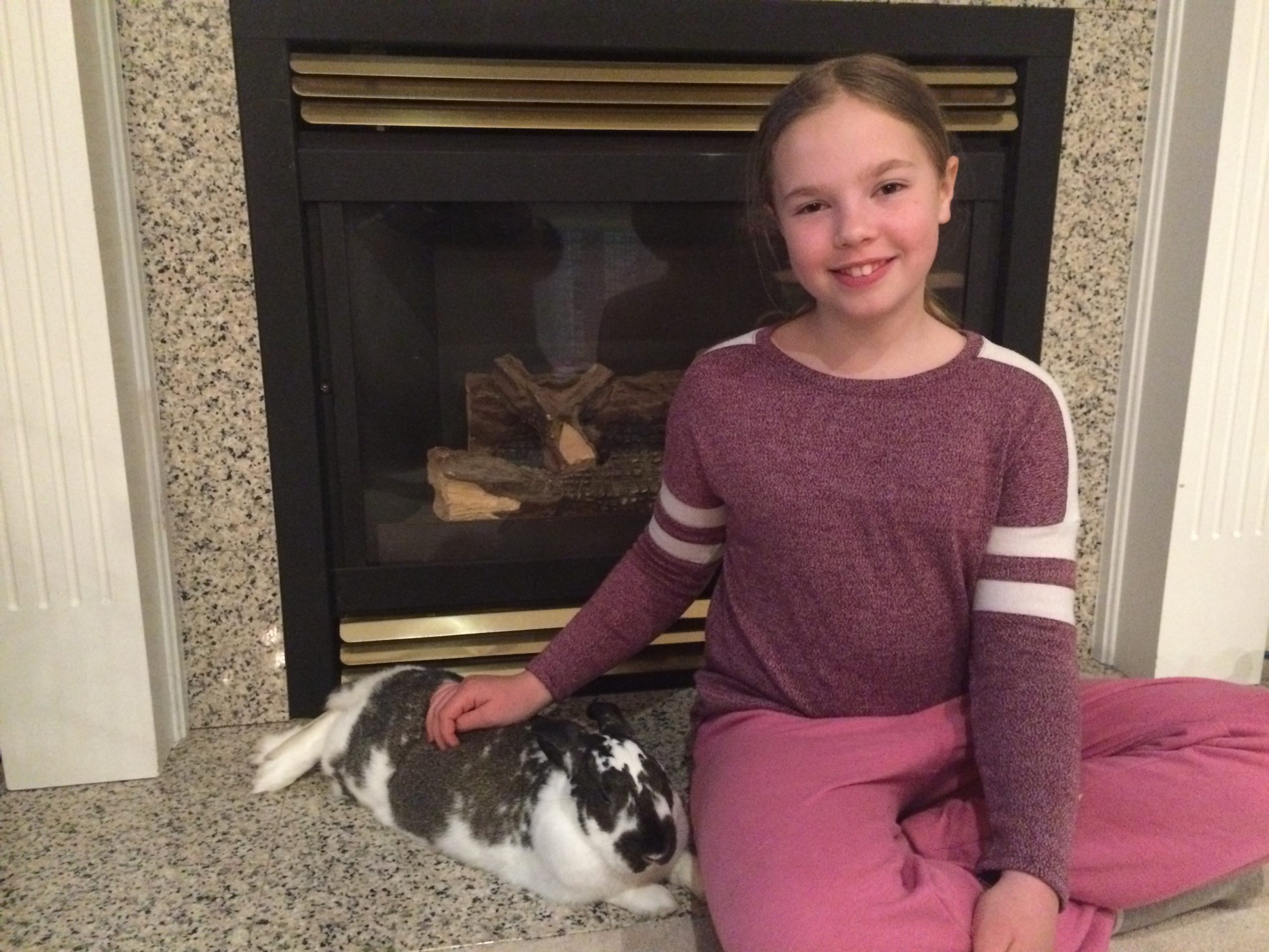 Member just relaxing with her 4-H rabbit
